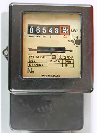 electromechanical: electric energy meter old electromechanical type Stock Photo
