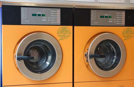 drycleaning: orange automatic washing machines