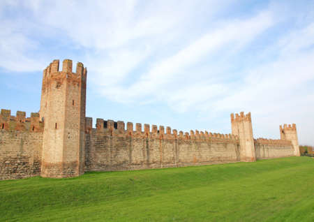moat wall: wall and towers of the medieval castle of Montagnana in Italy