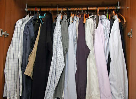 full open closet with many elegant shirts for important meetings photo