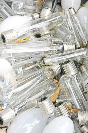 pile of broken bulbs and burned in the dump of the glass photo