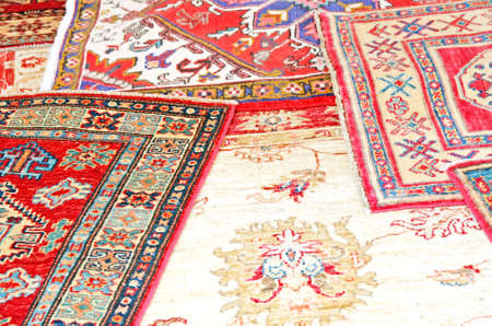 collection of antique oriental carpets expensive on display in the antiques boutique
