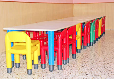 tables and chairs for a dining room table for a kindergarten photo