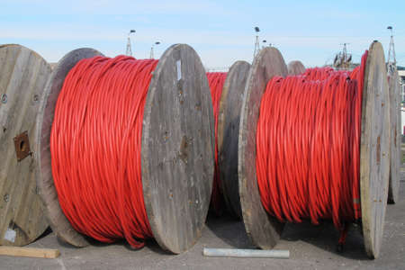 huge red electrical cable reels for the transport of electricity high voltage photo