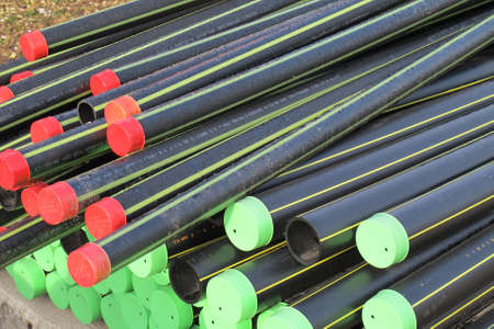 piles of plastic pipes and conduits for transporting water and gas Stock Photo - 17793034
