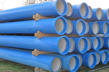 reclamation: piles of concrete pipes for transporting water and sewerage Stock Photo
