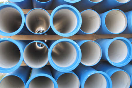piles of concrete pipes for transporting water and sewerage Stock Photo
