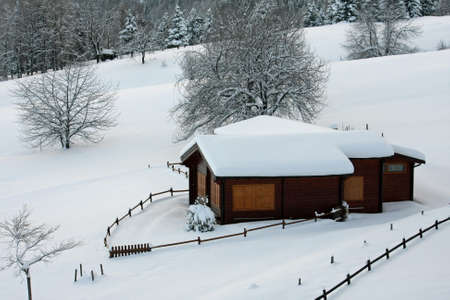 wooden mountain chalet in the Alps in Italy after a heavy snowfall Stock Photo - 17950301