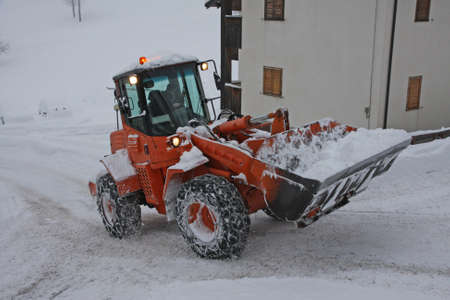 emergency lane: snow plough scraper with the bucket to remove all the snow from the road