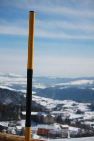delimit: yellow and black wooden pole to delimit the road to Snowplow in the mountains