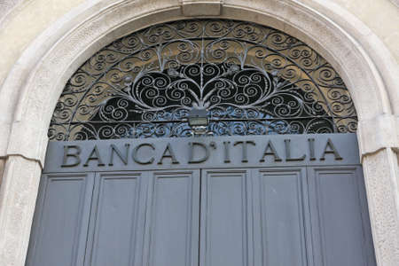 Bank of Italy door closed with the inscription above in wrought iron