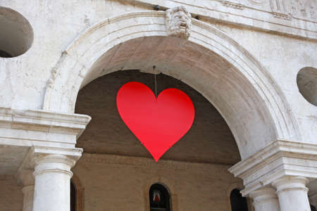 Red heart hung at the Basilica Palladiana in the Piazza dei Signori in vicenza on Valentine's day sweethearts party photo