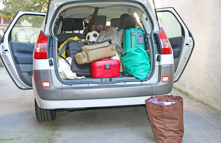 car trunk: car full of luggage before departure family holiday
