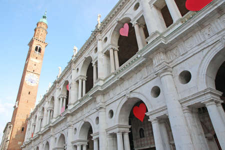 Red hearts hung at the Basilica Palladiana in the Piazza dei Signori in vicenza on Valentine's day sweethearts party photo
