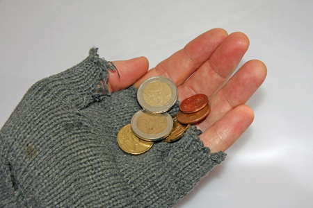 marginalized: hand of the poor man who asks the charity to a few euros Stock Photo