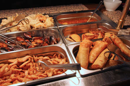 tasty fried spring rolls in Chinese buffet restaurant photo