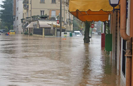 Streets and road invaded by mud during a flooding of the River 2 Stock Photo - 18113813