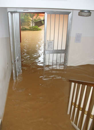 entrance and staircase of the House invaded by mud during a flooding of the River