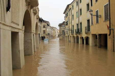 cars in the streets and roads submerged by the mud of the flood after the flooding of the River Stock Photo - 18119038