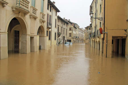 cars in the streets and roads submerged by the mud of the flood after the flooding of the River photo