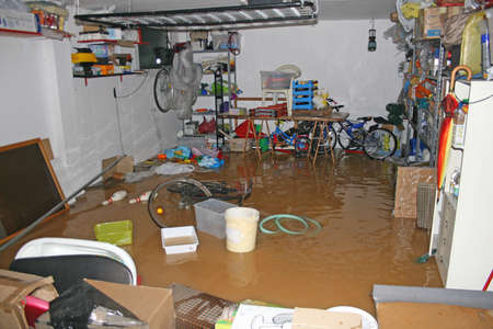 garage with bike and boxes during a flood