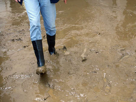 black boots in the mud during the emergence of a flooding of the River