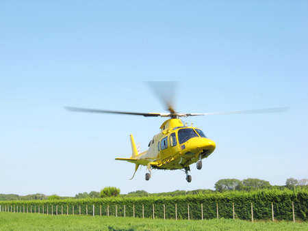 ambulance helicopter takes off fast carrying a serious injury photo
