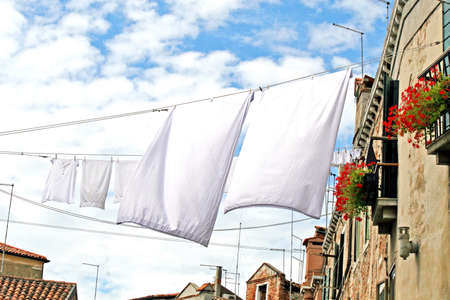 clothes hanging out to dry on a canal Banque d'images