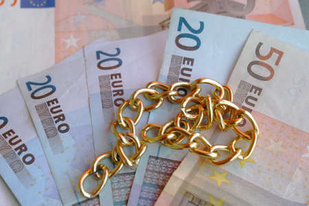 smuggling: necklace with money in euros in the background Stock Photo