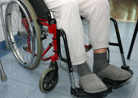 Elder patient with leg problems over the wheelchairs