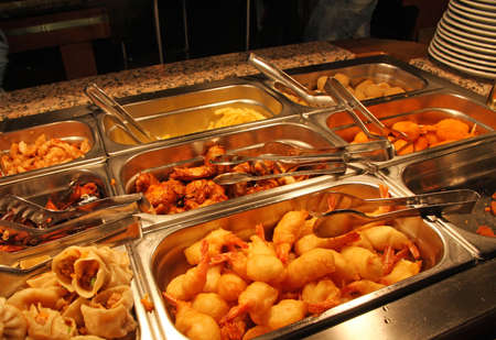 steel tray filled with fried meat and fish photo