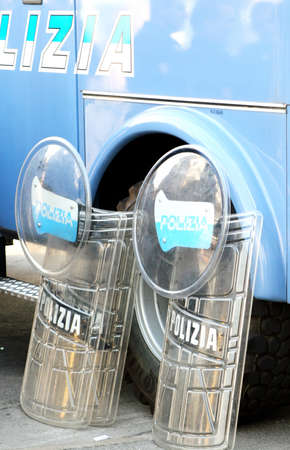 revolt: Italian police shields on the truck after the revolt Stock Photo