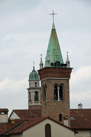 rise above: steeples of churches that rise above the houses of Vicenza in Italy