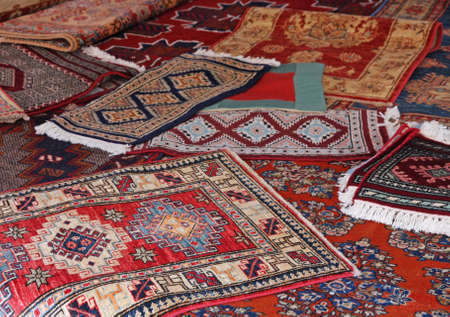textures and background of ancient handmade carpets and rugs photo