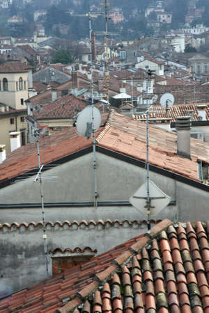 population growth: red tile rooftops and houses in an old Italian town Stock Photo