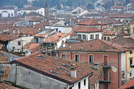overpopulation: red tile rooftops and houses in an old Italian town Stock Photo