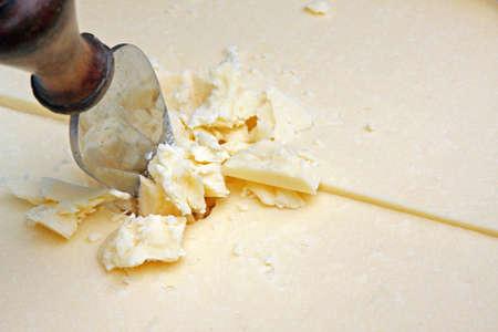 stracchino: cheese Parmesan reggiano or wheat sliced ready-to-serve as Flake apertivo. Stock Photo