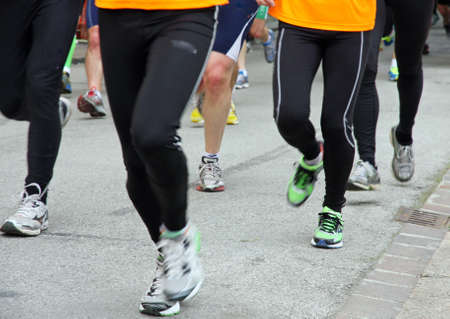athletes shoes runners during a race in the city photo