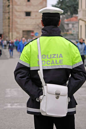 policeman in uniform with the inscription in Italian shall the city