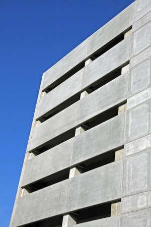 multi storey: facade of a skyscraper and multi storey indoor parking