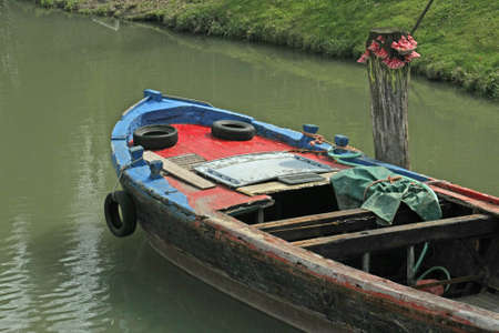 catapults: freight barge moored on the Canal before loading