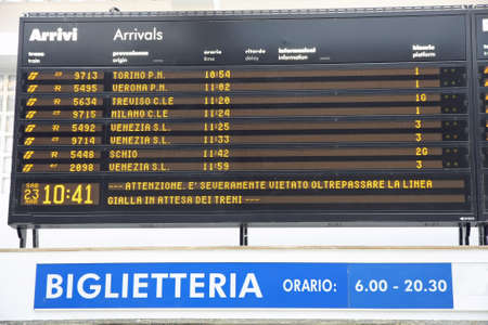 ticketing: Board schedules of arrivals and departures of trains in an Italian train station