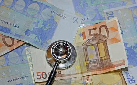 leaned: stethoscope doctor leaned on many sick euro currency banknotes