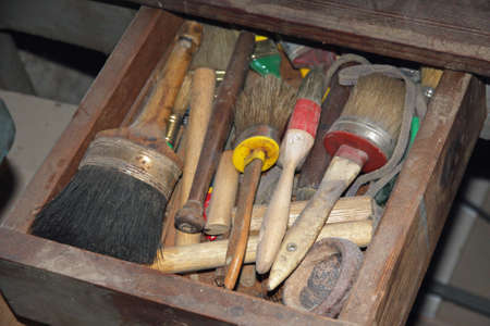 carpentery: tools in a dusty carpentry workshop expert in restoration of antique furniture Stock Photo
