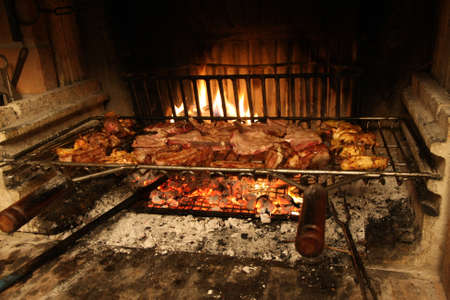 fireplace in the restaurant where you cook pork ribs and grilled steaks photo