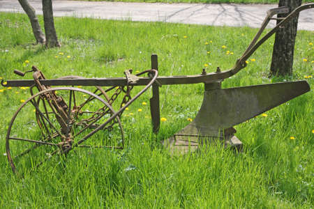 abandonment: old rusty plow to work the land in Meadow Green