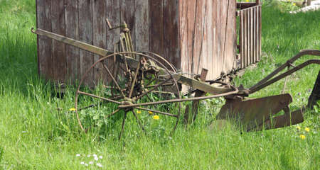disuse: old rusty plow to work the land in Meadow Green
