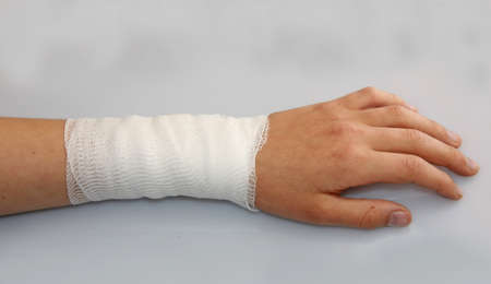 bandaged arm of a child because of a skin lesion Stock Photo