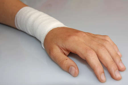 contusion: bandaged arm of a child because of a skin lesion Stock Photo