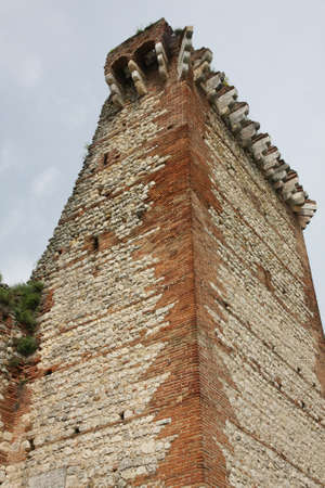 a war historian: ancient ruined Tower of the medieval castle of Romeo in montecchio Editorial